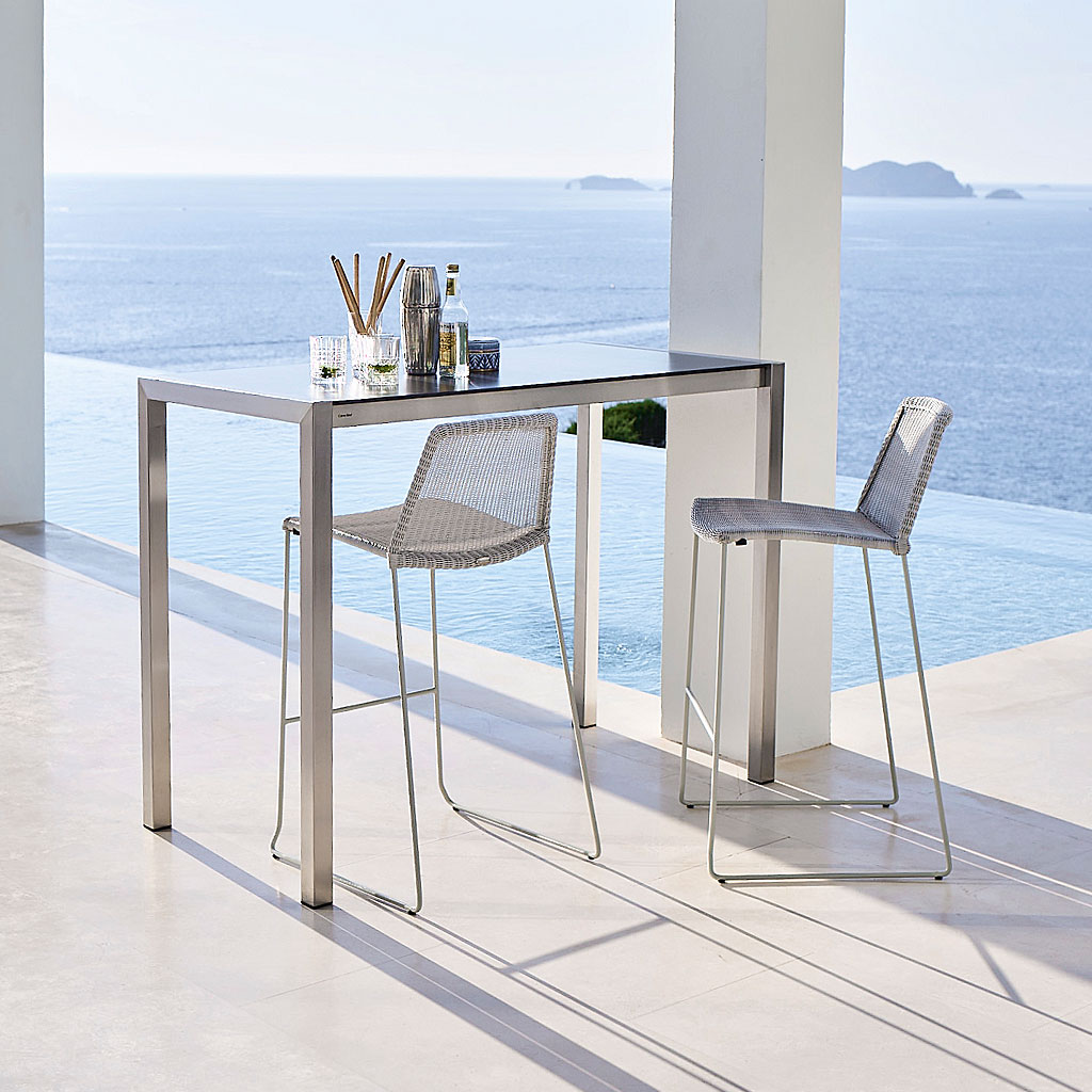 Light Grey Breeze Modern Bar Stool & Drop High Bar Table. Contemporary Outdoor Bar Chair & Hospitality Outdoor Bar Furniture In Luxury Quality Garden Furniture Materials Designed By Strand+Hvass For Cane-Line Modern Garden Furniture.