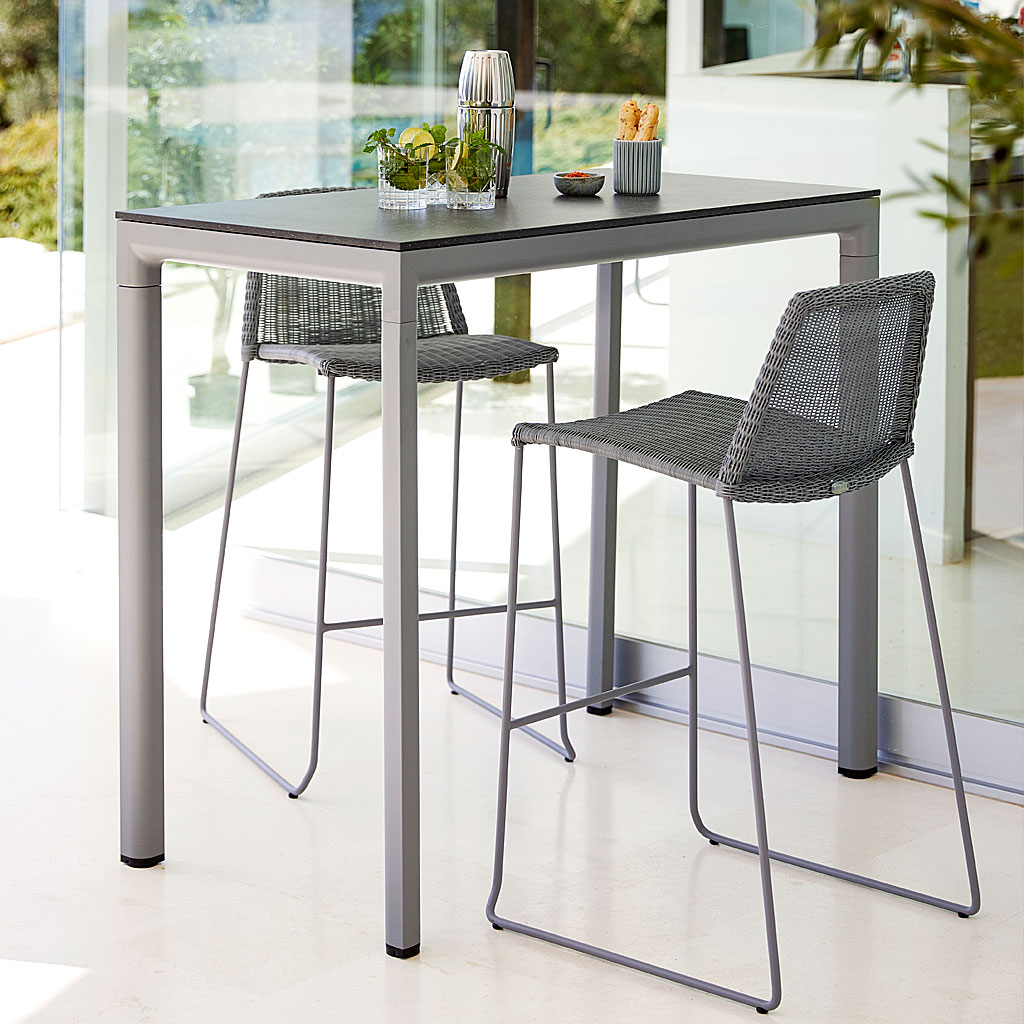 Black Breeze Modern Bar Stool & Drop Bar Table. Contemporary Outdoor Bar Chair & Hospitality Outdoor Bar Furniture In Luxury Quality Garden Furniture Materials Designed By Strand+Hvass For Cane-Line Modern Garden Furniture.