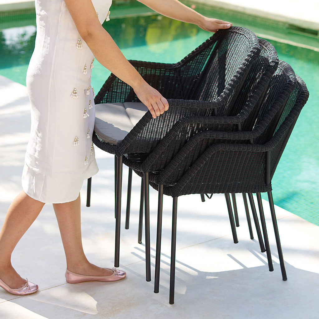 Lady Stacking Black Breeze MODERN Outdoor Dining CHAIR & Drop Bistro Table. DESIGNER Garden Chair By Strand+Hvass. Breeze WOVEN Garden Chair Is Made In HIGH QUALITY Garden FURNITURE Materials By CANE-LINE Luxury Garden Furniture.