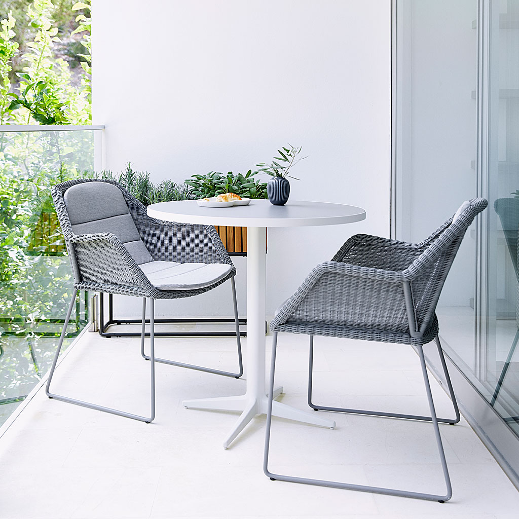 Light Grey Breeze MODERN Outdoor Dining CHAIR & Drop Bistro Table. DESIGNER Garden Chair By Strand+Hvass. Breeze WOVEN Garden Chair Is Made In HIGH QUALITY Garden FURNITURE Materials By CANE-LINE Luxury Garden Furniture.
