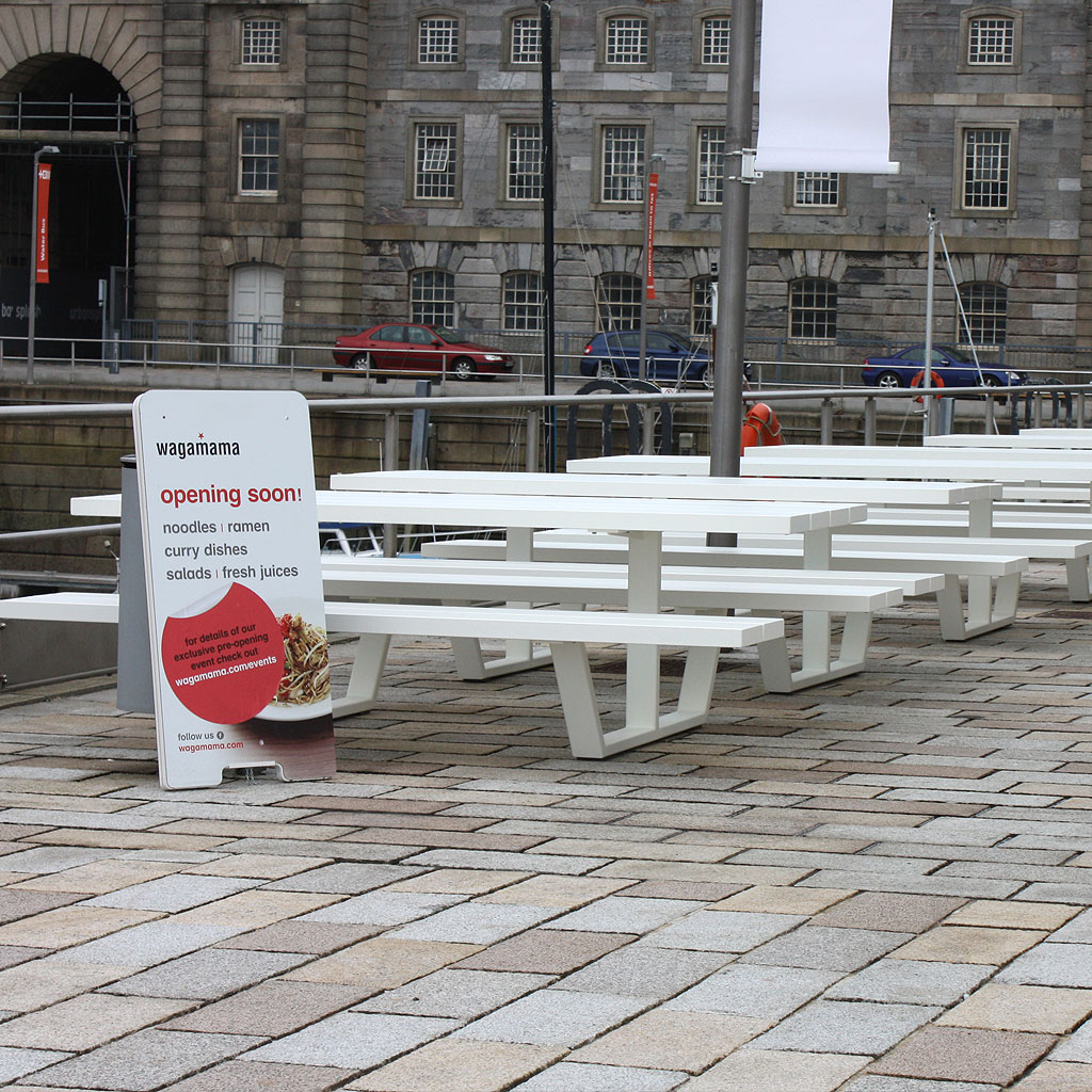 White Cassecroute MODERN Picnic Table & LUXURY PICNIC FURNITURE At Wagamama Restaurant, Plymouth Historic Dockyard. SHORT Or LONG Picnic Table Sizes Up To 14m Made In High QUALITY Picnic Furniture Materials. Cassecroute DESIGNER Picnic FURNITURE Designed By Ronald Mattelé.