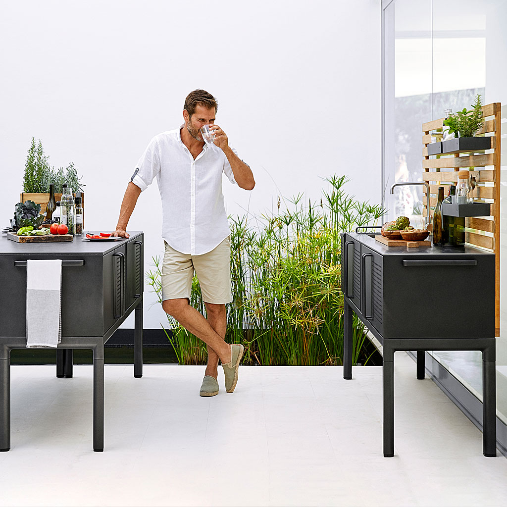 Dude Hitting The Booze Next To DROP Outdoor KITCHEN. MODERN Garden Kitchen CABINET, OUTDOOR Kitchen ISLAND, HIGH QUALITY Garden Furniture MATERIALS. CANE-LINE Luxury Garden Furniture.