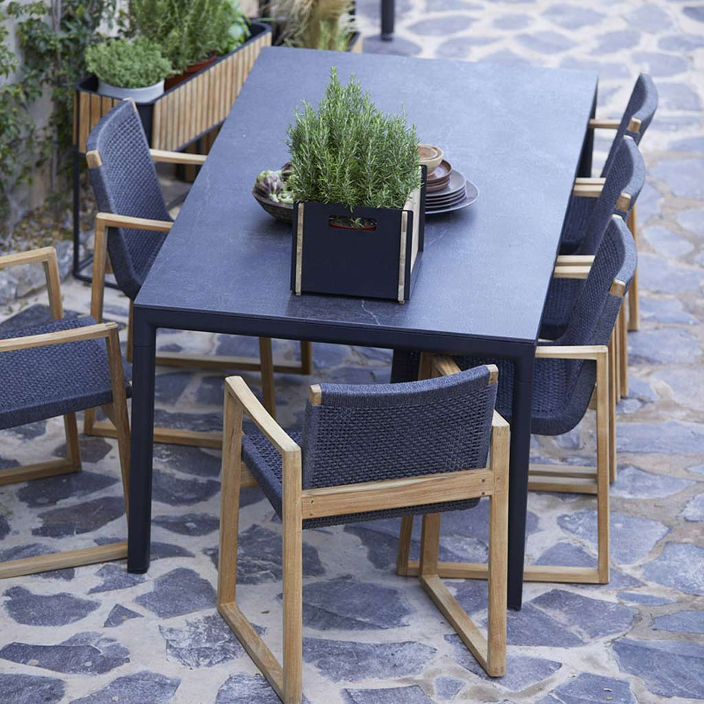 Endless Outdoor Carver & Drop Modern Outdoor Table Is A Simple Garden Table Available As Rectangular Tables, Extending Tables, Bar And Bistro Tables - Made In High Quality Outdoor Furniture By Cane-line All-Weather Furniture