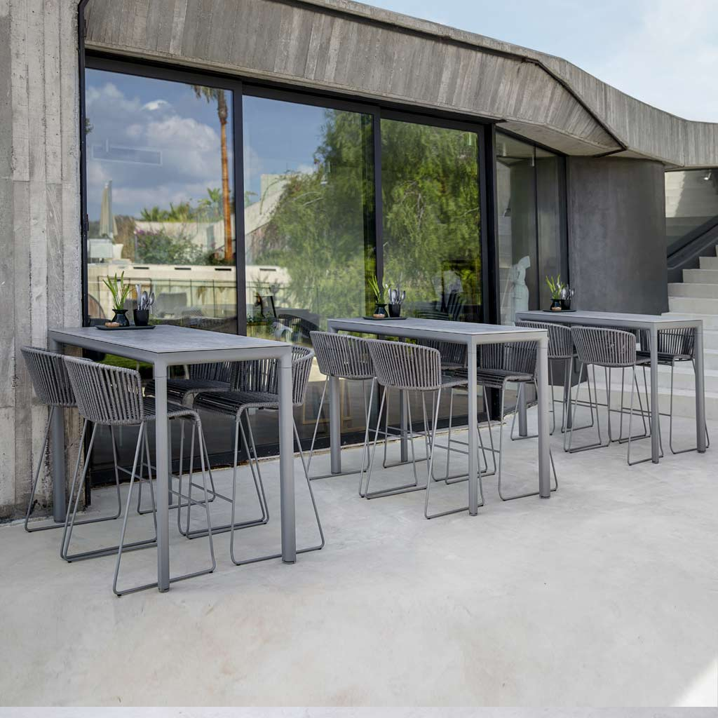 Drop Bar Table & MOMENTS Modern GARDEN BAR STOOL Is An Outdoor High Bar Chair In ALL-WEATHER Garden Furniture MATERIALS By CANE-LINE Danish GARDEN FURNITURE